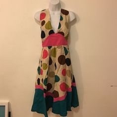 Pretty Polk a Dot sundress size S Perfect sundress for Spring Break! It is light 100% cotton, it zips on the side, ties on the back of the neck. I put some boobie cups in it, I personally prefer it that way. Worn and washed once. FumbLin 'Foe Dresses Backless