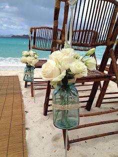 Mason jar beach wedding chair hangers.