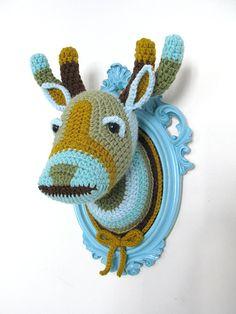 crochet deer head in a light blue frame