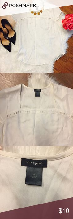 Ann Taylor Square Neck Blouse Office envy alert! Check out this cute square neck Ann Taylor Blouse. Off-white/cream with short sleeves and geometric hole detail across front. Goes great with a skirt or pants! EUC Worn only a few times and dry cleaned. Wrinkled from being in drawer.. wrinkles will very easily iron or steam out. Care instructions indicate cool iron if needed ✨ bundles discounted! Reasonable offers encouraged Ann Taylor Tops Blouses