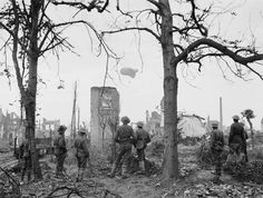 Oct 27, 1917: Australian soldiers watch an observation balloon descend of Ypres, Belgium.