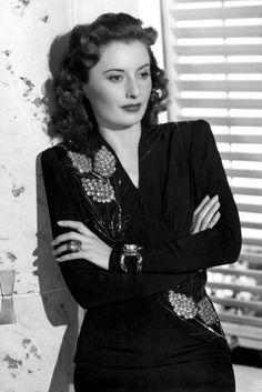 Barbara Stanwyck, 1941. Embellishment and huge cocktail jewels made Barbara Stanwyck look like a total screen goddess in 1941.