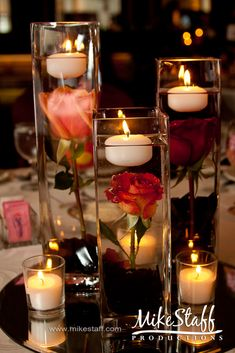 #wedding reception decorations #centerpieces #tablescapes #reception details #Michigan wedding #Mike Staff Productions #wedding details #wedding photography http://www.mikestaff.com/services/photography #floating candles #roses