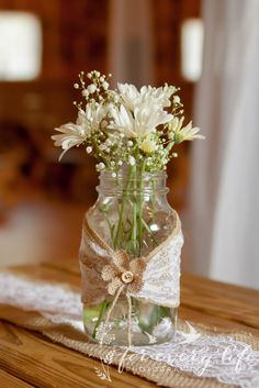 I wonder if and when I will ever get over being obsessed with lace, burlap and country styled weddings! <3   Mason jar centerpieces with lace and burlap, daisies and baby's breath flowers.  Lace and burlap runners on picnic style tables.  Wedding reception decor for a country wedding