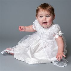 Our Scarlett White Silk Christening Dress is a delightful dress for your baby. At ChristeningGowns.com we specialize in infant clothes for christenings, baptisms, and family portraits.