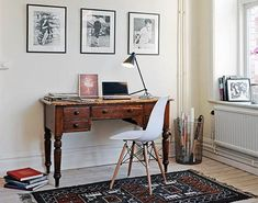 home office design in a corner of a room with wooden writing desk and chair using feng shui