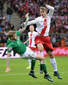 Lukasz Piszczek and James McClean at at the UEFA Euro 2016 Qualifying (Poland vs Ireland) Copyright B&O Press Photo.