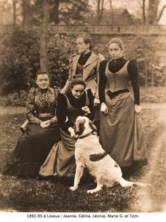 Celine and Leonie Martin (Therese's sisters) with their cousins Jeanne and Marie Guerin.  Tom, the family dog, got in the picture, too.