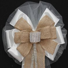 "This bling and burlap rustic wedding bow is the perfect combination of burlap and diamond bling for a sparkling rustic theme wedding. Bow Details: - 8 loops of 6"" white tulle (also available in ivory)"