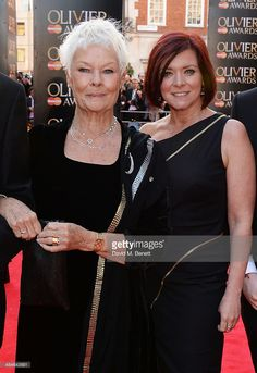 Dame Judi Dench (L) and Finty Williams attend the Laurence Olivier Awards at The Royal Opera House on April 13, 2014 in London, England.