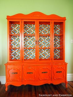 China cabinet is given new live with a BRAVE choice of bright orange and a retro hand-painted backboard {Reality Daydream}