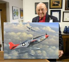 """WWII Veteran, Bob Friend of the 332nd Fighter Group """"Red Tails"""" with the Tuskegee Airmen. Bob is the oldest surviving Tuskegee Airman. The P-51 """"Bunny"""" is scheduled to be at the air show painted in the markings of the plane Bob flew in WWII. Bob is shown here with a painting of Bunny. Bob served 30 years in the Military Source: Planes of Fame - Veteran's History Project (Facebook)"""