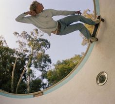 """Jeff Jones Stands on Coping"" 1976, skateboarding series by Hugh Holland."