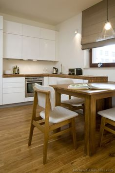 #Kitchen Idea of the Day: A small modern white kitchen with beautiful wood-grain countertops.