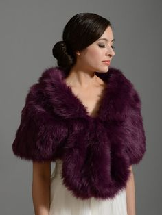 Faux fur wrap bridal shrug in purple color, fully lined with satin. There is a hook and eye closure in the front to fasten the wrap. Its perfect for