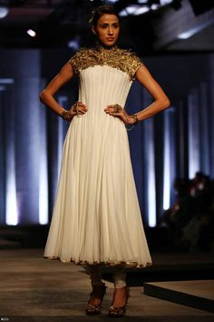 Alecia Raut showcases a creation by designers Shantanu and Nikhil on Day 1 of India Bridal Fashion Week, held in New Delhi, on July 23, 2013.