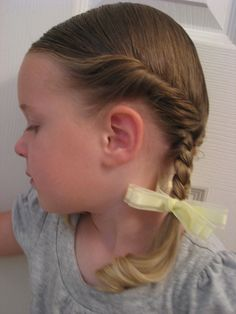 """or as we call them at our house """"Little House on the Prairie"""" braids (for those of you who remember that show!) But to dress them up a little, you can also do them like Dorothy in the Wizard of Oz. If you look closely, Dorothy doesn't just have braids, but the side of her hair"""