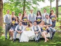 The bridesmaids wore steel gray dresses from David's Bridal. The groomsmen were cool and comfortable with lightweight gray vests and trouser