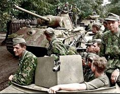 Excellent color photo of Waffen SS Troops with Halftracks and Panther Ausf G tanks in France 1944
