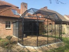 Wish I had this aviary coming off the house for our parrots.