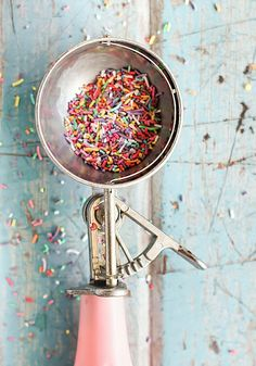 colourful sprinkles and pink ice cream scoop photo