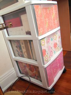 Brilliant - slip scrapbook paper in the front of each drawer! Gives you a pop of color and hides those typically-hideous drawers!  Get plastic drawers at Flower Factory  http://www.flowerfactory.com/p-74396-storage-3-drawer-cart-white.aspx