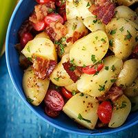 BLT Potato Salad     1 pound baby potatoes  Kosher salt and ground black pepper   1/2 pound cooked bacon, torn into 1-inch pieces, grease reserved   2 tablespoons red wine vinegar   1 tablespoon whole-grain mustard   1 pint cherry tomatoes, halved   1/4 cup chopped flat-leaf parsley