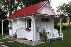 White garden shed with a red tin roof! Love the door & decorative woodwork. Potting shed, tiny house, barn doors
