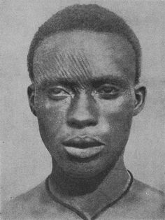 """Igbo Tribe. Nigeria. """"Ichi"""" are facial ritual scarification  worn mostly by male tribe members to indicate nobility. 1921."""