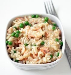 Salmon & Pea Risotto Ingredients: 5 cups chicken or fish stock 3 cups chopped cooked salmon 1 cup frozen peas 2 large shallots, minced 2 cloves garlic, minced 2 cups Arborio rice 1/3 cup Parmesan, grated 2 tablespoons olive oil zest one lemon salt pepper