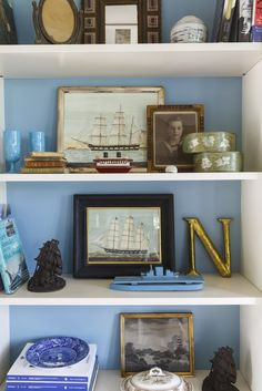 This house is filled with the signatures of Nantucket decor: sisal rugs, bowls of shells, and gray and blue tones.