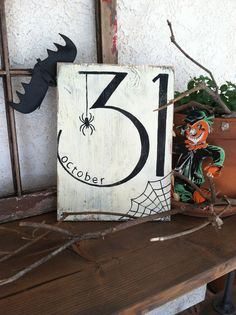 Great Halloween Chic hand painted sign measuring approximately 12 x 16. Done in an off white background with black letters and distressed with black showing through to give it a spooky, aged feel. Sign says october 31 with a spider and web on it. Fun for your front door, wall, or halloween party!  *Unless otherwise noted, my signs are made to order. They are created once you place your order. Because of these, each sign will vary slightly from the picture, depending on the grain and knots in…