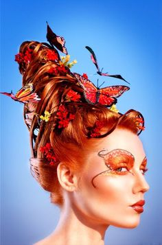 Avant garde hairstyle with butterflies by Shawn Arrington.