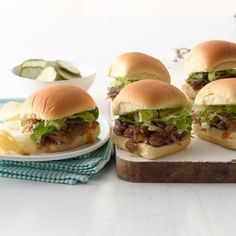 Pulled pork sliders with romaine slaw - http://www.womansday.com/recipefinder/pulled-pork-sliders-romaine-slaw-recipe-wdy0313