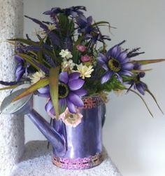 purple watering can arrangement