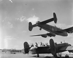 Low-level 'beat-up'. A Halifax II, JB911/KN-X of No 77 Squadron roars low over an audience of appreciative 'erks' during air tests at Elvington, Yorkshire, July 1943