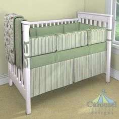 Crib bedding in Heather Sage Green, Sage Stripe, Solid Sage Minky, Watercolor Forest. Created using the Nursery Designer® by Carousel Designs where you mix and match from hundreds of fabrics to create your own unique baby bedding. #carouseldesigns