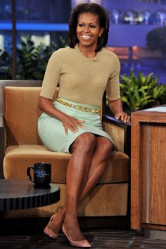 Michelle Obama  2012 - The First Lady on 'The Tonight Show with Jay Leno' stage in a Michael Kors gold crew neck and a J. Crew skirt accessorized with a House of Lavande jeweled belt and blush pumps.