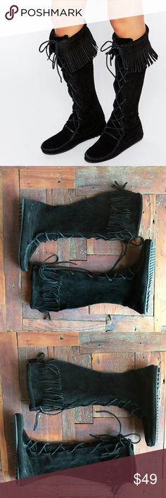 Minnetonka Lace Up Tall Moccasin Fringe Native Minnetonka tall moccasin boots. Genuine suede. Lace up front. Fringe tassels around the top. Rubber sole. Worn once, excellent preowned condition. Overall height is 17 inches. All black. Seen on Kate Moss and many other celebs. Native American Tribal Hippie style. Bundle and save 20%! Minnetonka Shoes Lace Up Boots