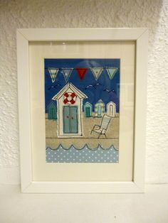 A summery textile beach hut picture. I have used linen and cotton fabrics for the design which has been appliquéd and machine embroidered' The textile art has been framed in a sturdy white frame. It would look very attractive in a nautical themed bathr. Free Motion Embroidery, Free Machine Embroidery, Embroidery Art, Fabric Cards, Fabric Postcards, Seaside Theme, Creative Textiles, Fabric Pictures, Framed Fabric