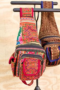Hill Tribe Antique Fabric Backpacks ~ Hand embroidery in intricate patterns by the hill tribes of Thailand. We love these little one shoulder backpacks!