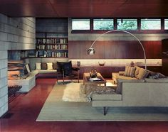 "Nice ""woodsy"" modernist interior.  Note the Finn Juhl ""Chieftain"" chair in the far upper left."