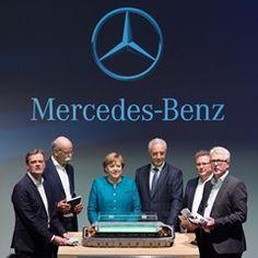 German Chancellor Angela Merkel talks with Mercedes-Benz CEO Dieter Zetsche