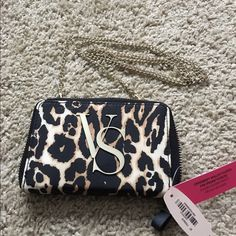 """✨NWT- VS Crossbody Wallet Clutch & iPhone Case✨ ✨NWT- VS Crossbody Wallet Clutch & iPhone Case✨ Fun Cheetah print cross-body clutch with gold VS emblem of front. Holds iPhone 5/5S/5C along with an ID & card holders. """"Purrr-fect"""" to take out on the town! Victoria's Secret Bags Crossbody Bags"""