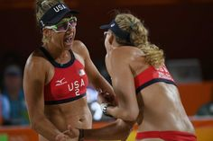 USA's April Ross (L) and USA's Kerri Walsh Jennings react during the women's beach volleyball qualifying match between the USA and…