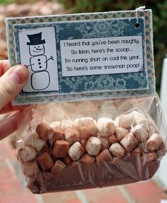 Snowman poop/soup: Each baggie should contain enough hot chocolate mix for 1 serving, 12-15 mini marshmallows  (these people went overkill) and 2-3 Hershey kisses. Add the poem and taaa duuummm... a cute gift!