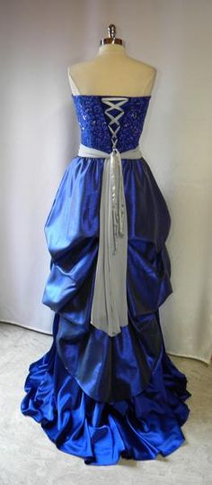 A really funky and wild masquerade ball party dress, vibrant blue and silver, lace up back and puffy bustled. #masquerade #blue #gown