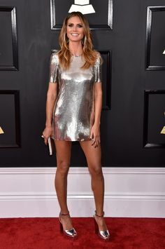 2017 Grammys: Heidi Klum wore a metallic silver Philipp Plein short sleeve t shirt dress. Adorable little metallic dress! I love the matching metallic silver platform heels! Legs for days! I love the effortless look! Women's Dresses, Nice Dresses, Short Dresses, Sleeve Dresses, Metallic Dress, Silver Dress, Metallic Leather, Sequin Dress, Grammys 2017