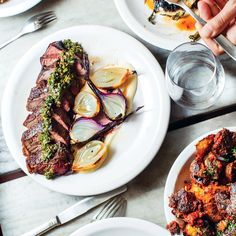 This Tri-Tip Steak a la Parrilla with Chimichurri and Roasted Onions is Mettā chef Norberto Piattoni's way of getting the most out of your grill. Get the recipe at Food & Wine. Beef Steak Recipes, Meat Recipes, Wine Recipes, Yummy Recipes, Entree Recipes, Grilling Recipes, Roasted Onions, Tri Tip, Grilling