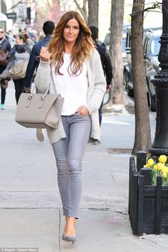 Laid-back: Kelly's final look was a bit more casual, as she sported a cozy grey sweater an...